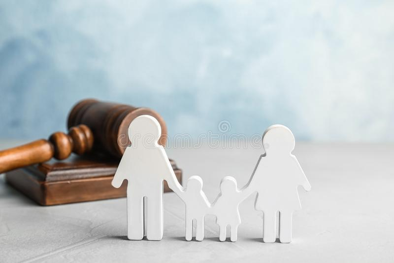 Family figure and gavel on table. Family law concept royalty free stock photo
