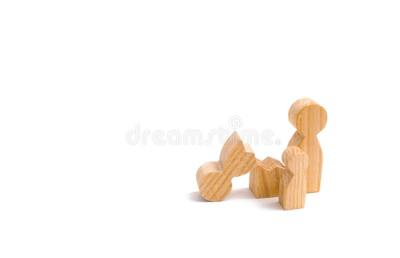 Family figures, one of the parents is broken. Survivor`s loss concept. The death of a parent. Divorce, single mother royalty free stock images