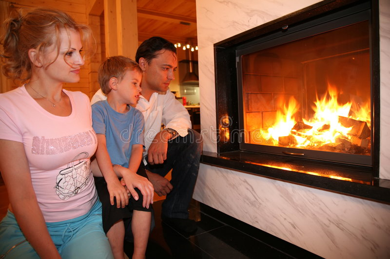 Family and fireplace. Family seating near the fireplace stock photography