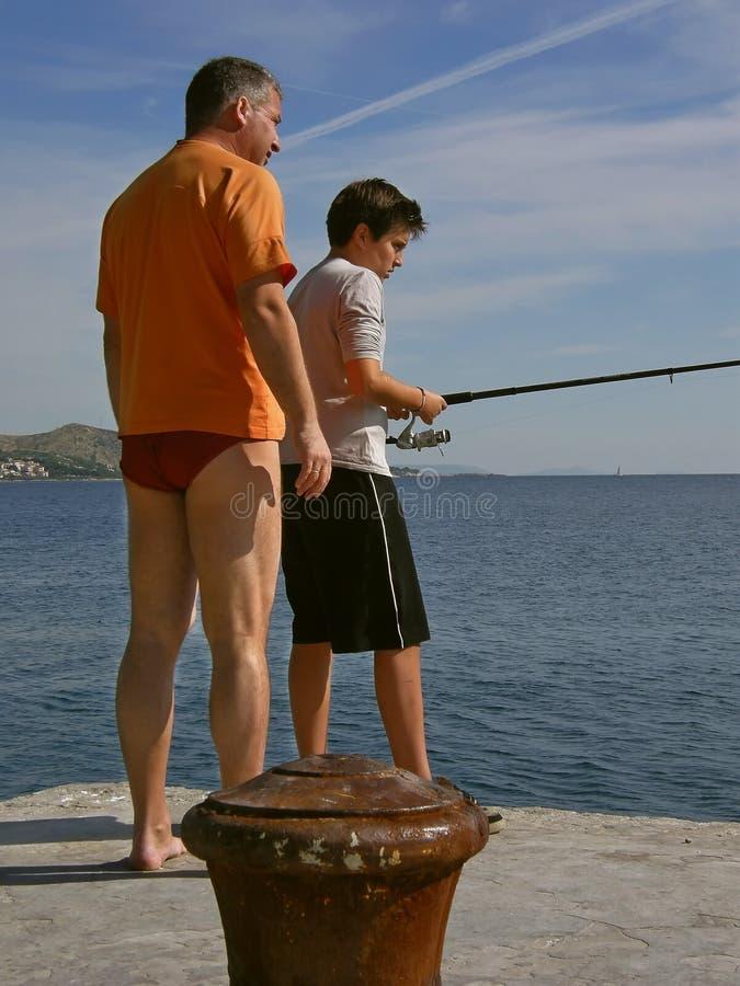 Family fishing 1 stock image