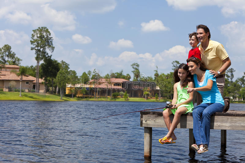 Family Fishing On Jetty By Lake royalty free stock photo