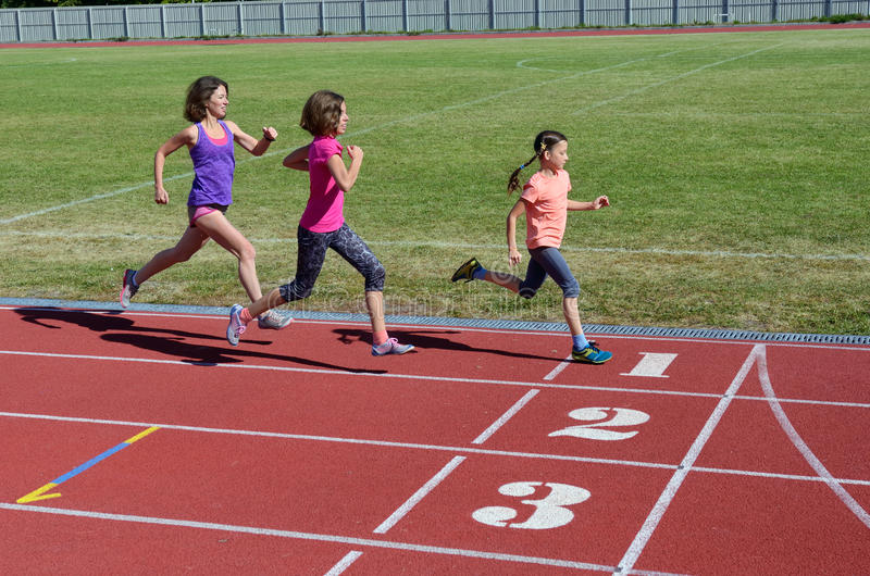 Family fitness, mother and kids running on stadium track, training and children sport healthy lifestyle. Concept stock photography