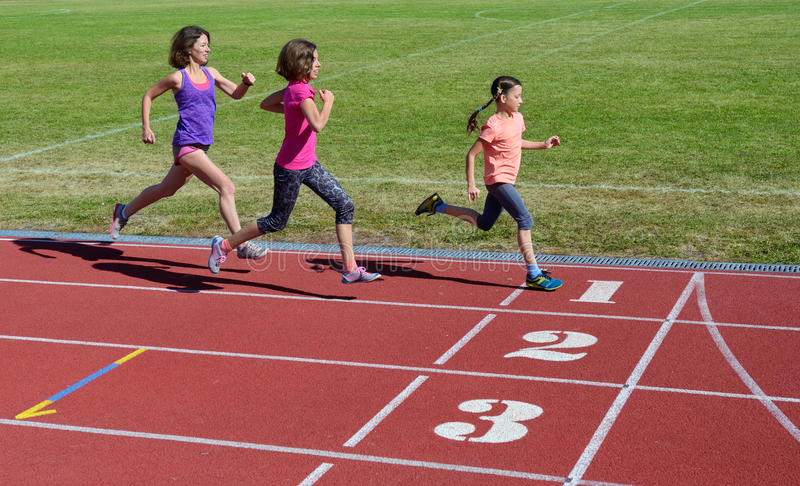 Family fitness, mother and kids running on stadium track, training and children sport healthy lifestyle. Concept royalty free stock photos