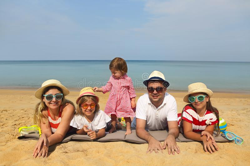 Family of five on the beach royalty free stock photos