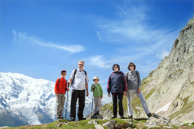 The family from five persons stays against massif of Mont Blanc royalty free stock image