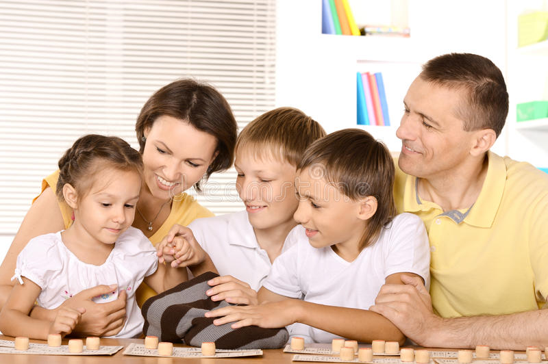 Family of five playing royalty free stock image