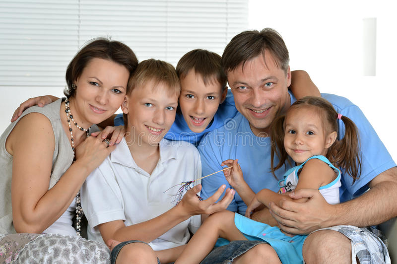 Family of a five sitting stock image