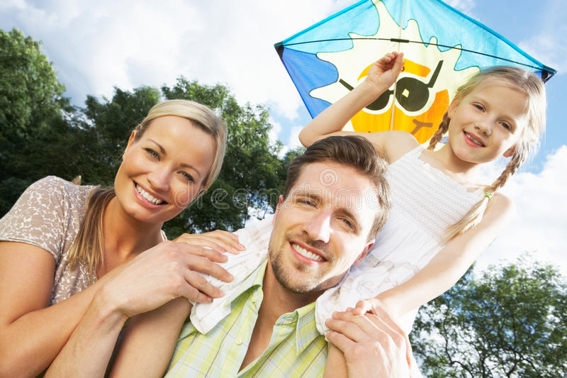 Family Flying Kite In Countryside royalty free stock photo