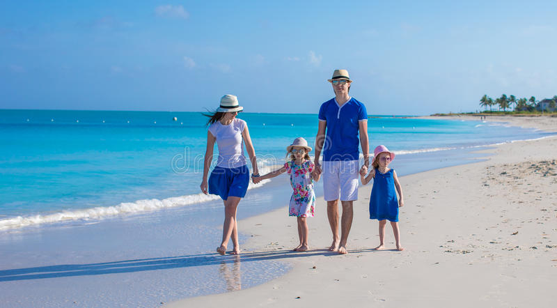 Family of four on beach vacation stock image
