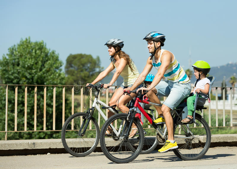 Family of four with bikes stock photography