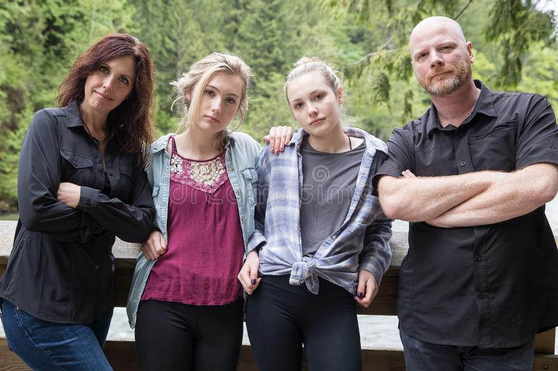Family of four. With tough and serious expressions stock images