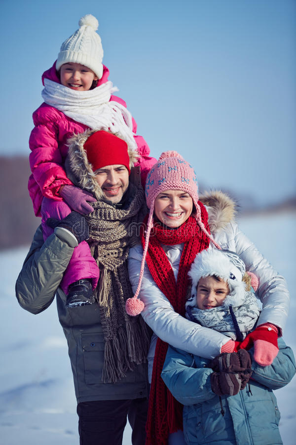 Family of four. Happy family in winterwear outside royalty free stock photos