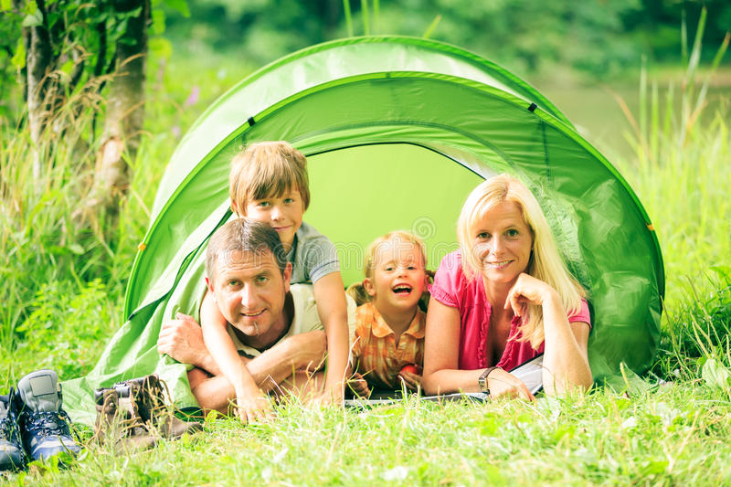 Download Family Of Four Having Fun Outdoors In The Summer Stock Image - Image: 83701073