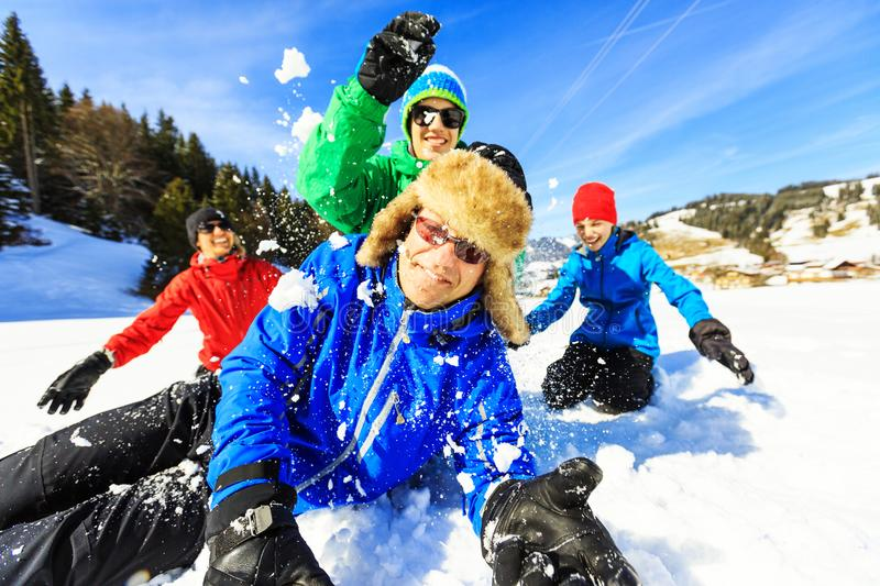 Family Of Four Having Fun In The Snow royalty free stock photo