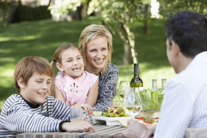 Family Of Four Having Picnic In Park stock image