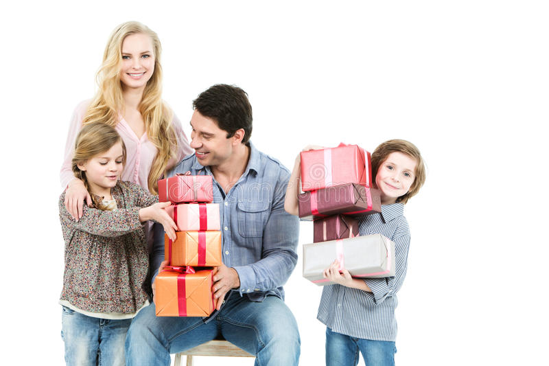 Family of four holding boxes with gifts. royalty free stock images