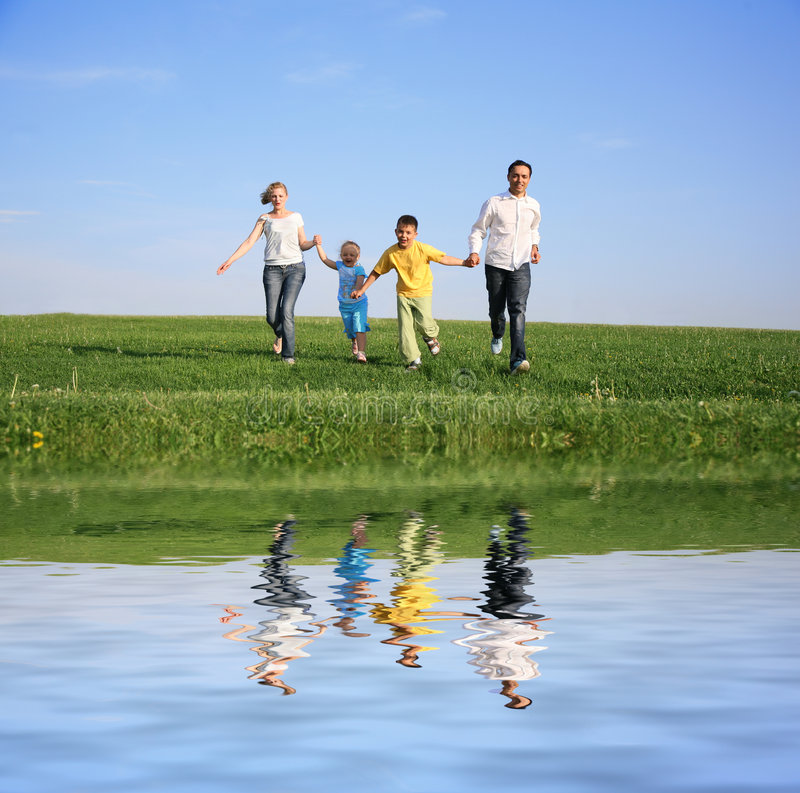 Download Family of four running stock photo. Image of outside, joyful - 4496518