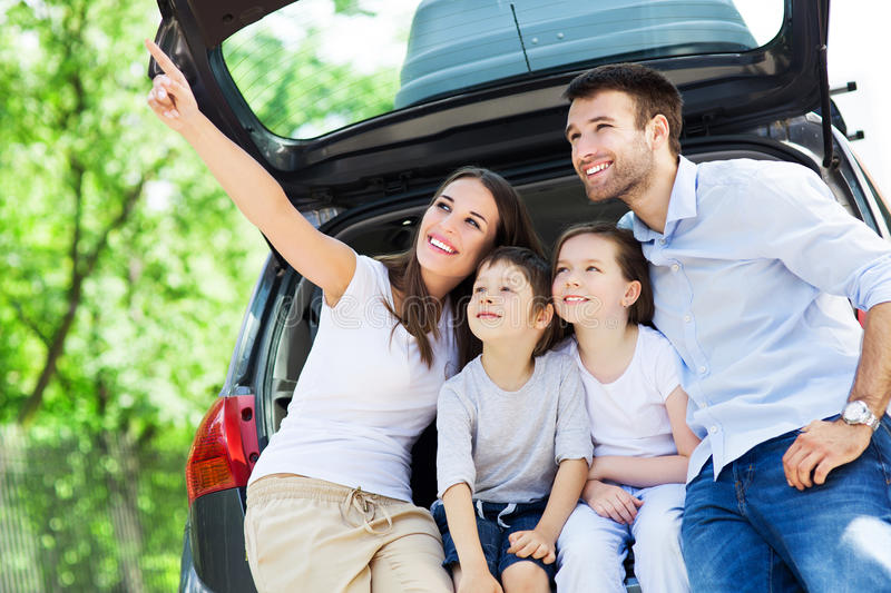 Download Family Of Four Sitting In Car Trunk Stock Photo - Image: 41843604