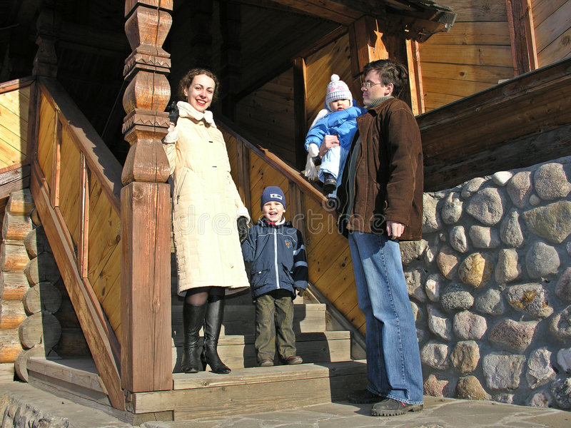 Download Family Of Four At Staircase Of Big Wood Home Stock Photos - Image: 367243