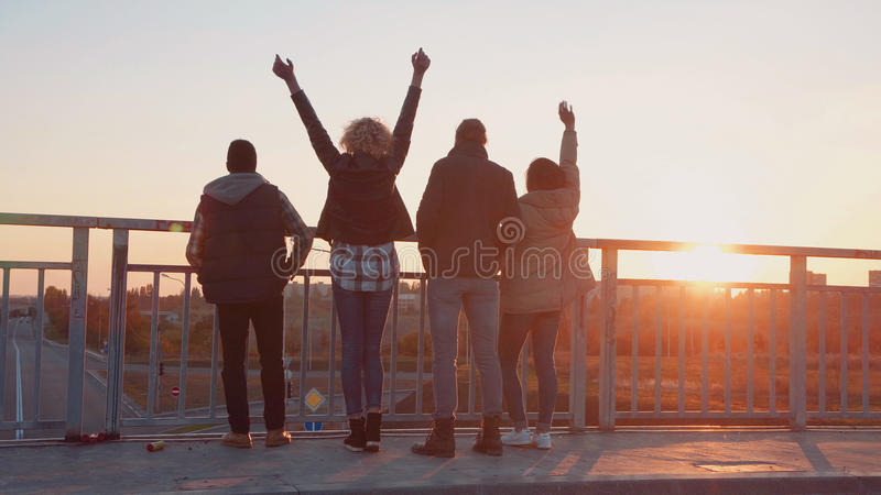 Family of four stands at barrier to observe nature royalty free stock photography