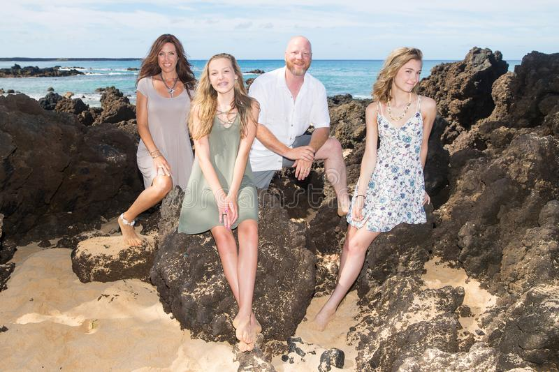 Happy Family together at the beach. Family of four on vacation at tropical island royalty free stock images