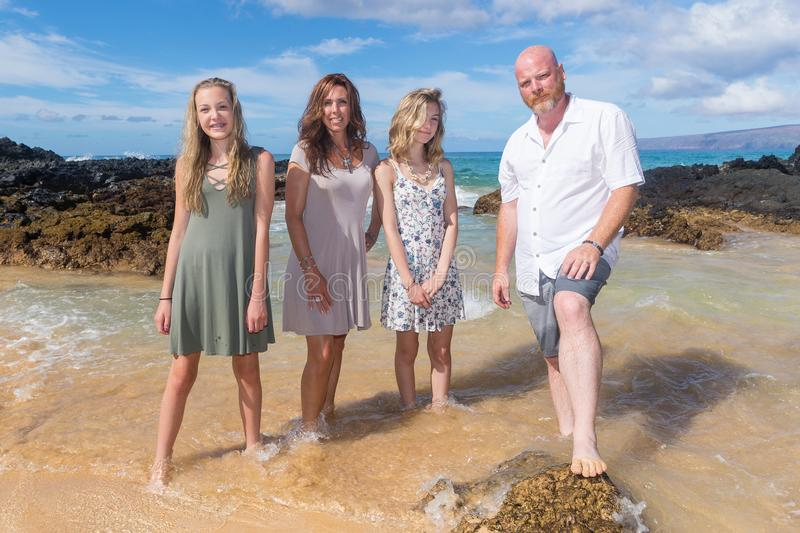 Happy Family together at the beach. Family of four on vacation at tropical island stock photos