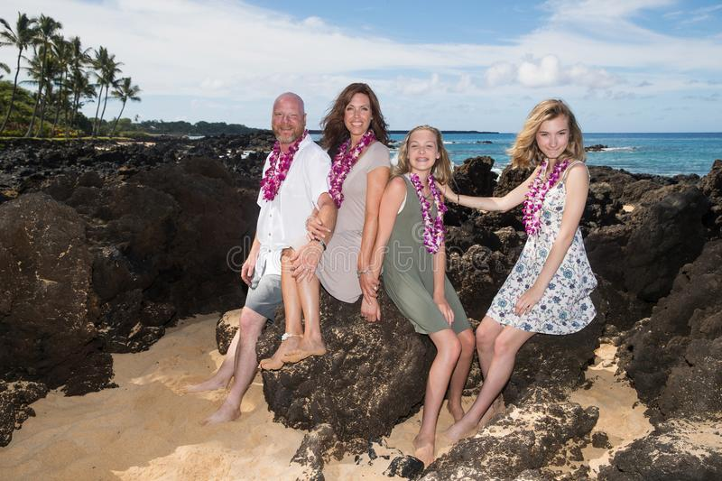 Happy Family together at the beach. Family of four on vacation at tropical island royalty free stock image