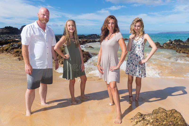 Happy Family together at the beach. Family of four on vacation at tropical island royalty free stock photos