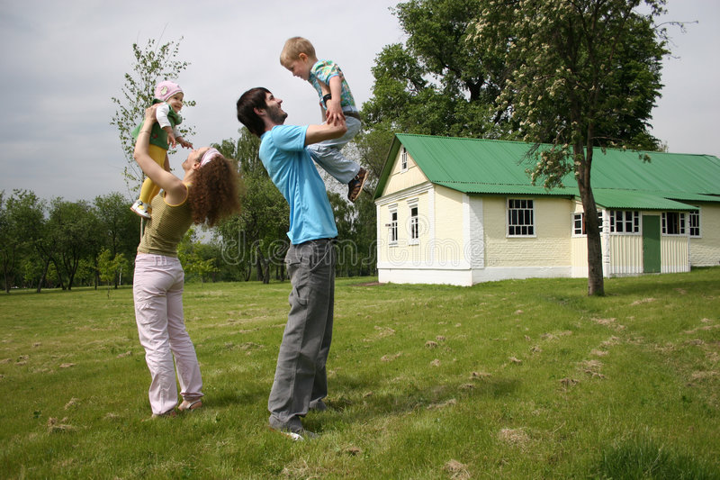 Family of four in yard stock image