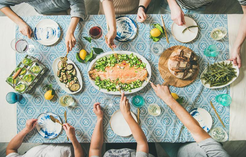 Family or friends having seafood summer dinner stock photo