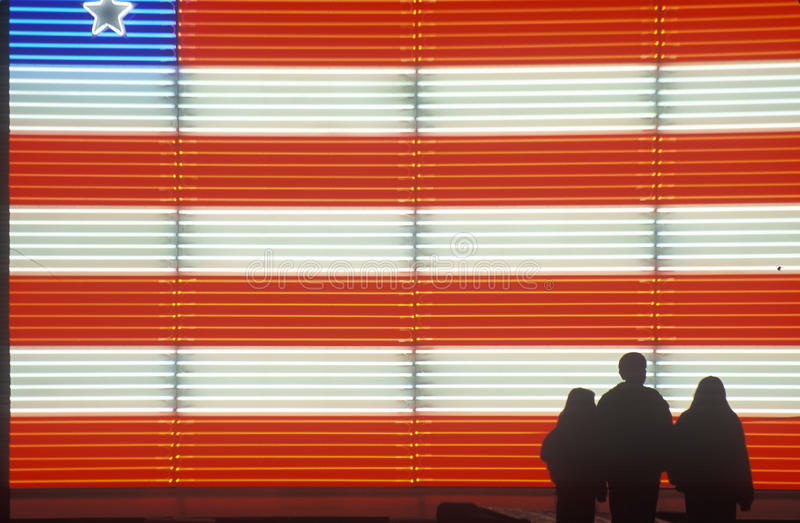 Download Family In Front Of An American Flag Stock Image - Image: 26890875