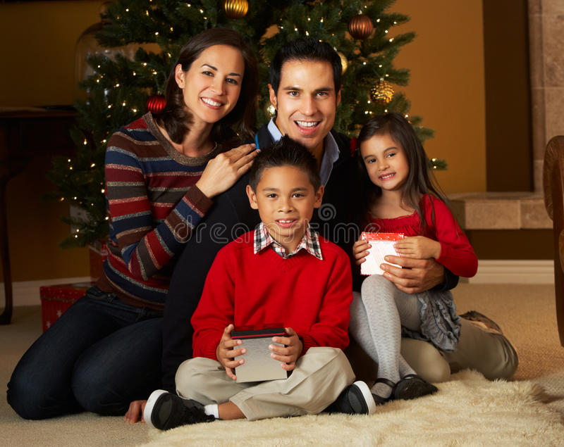 Download Family In Front Of Christmas Tree Stock Image - Image: 27960673