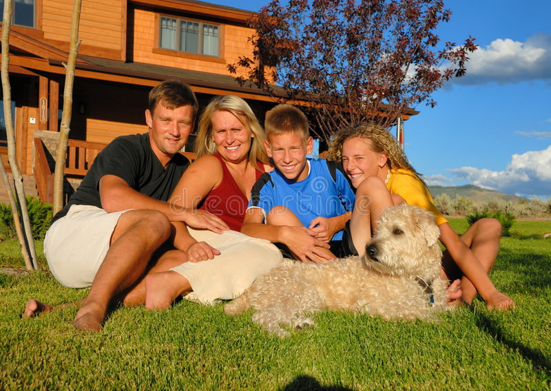 Download Family in front of home stock image. Image of canine, members - 4029743