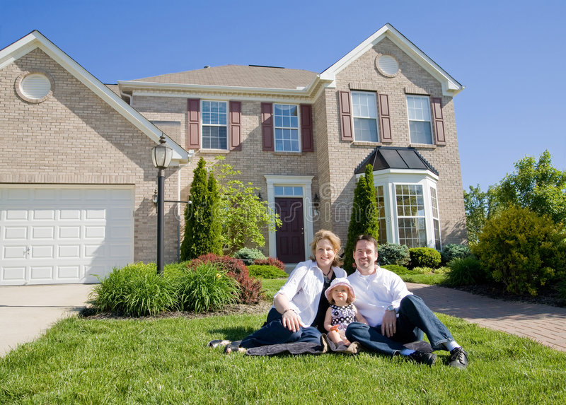 Family in Front of House royalty free stock images