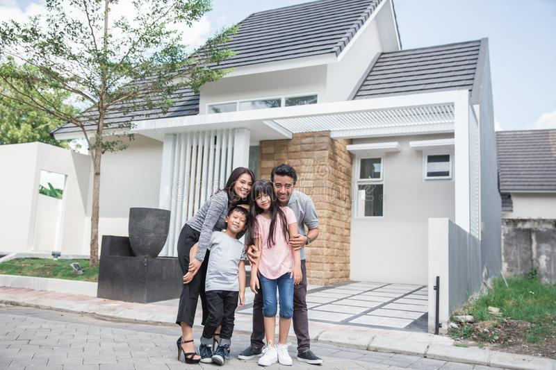 Family in front of their new house stock photos