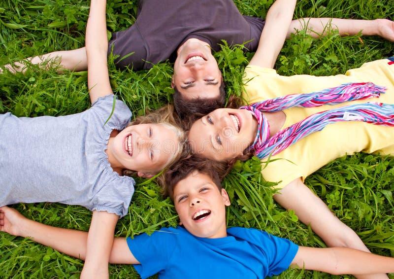 Family-fun 14. Cute family having fun in a meadow stock image