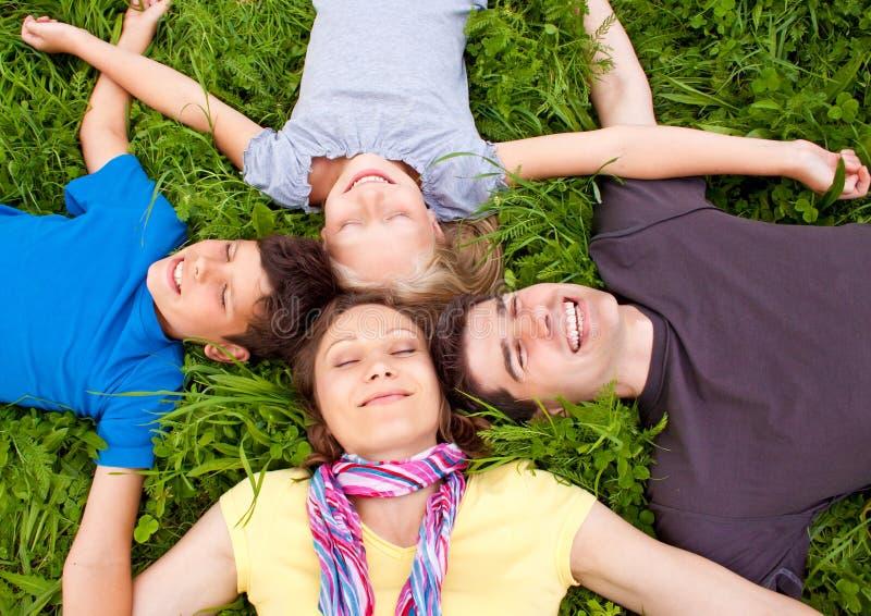Family-fun 15. Cute family having fun in a meadow stock photos
