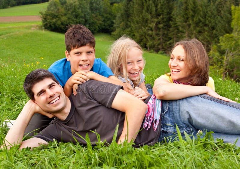 Family-fun 16. Cute family having fun in a meadow stock image
