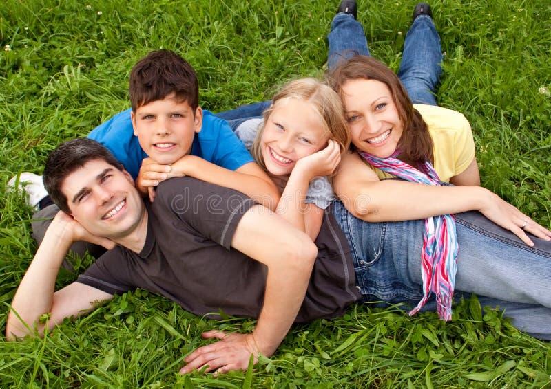 Family-fun 17. Cute family having fun in a meadow royalty free stock photos