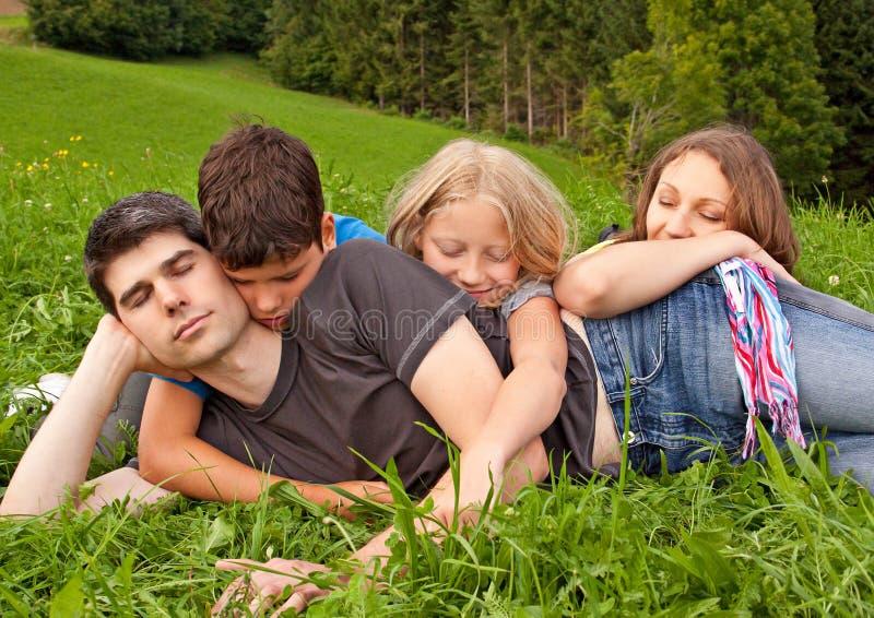 Family-fun 21. Cute family having fun in a meadow stock photography