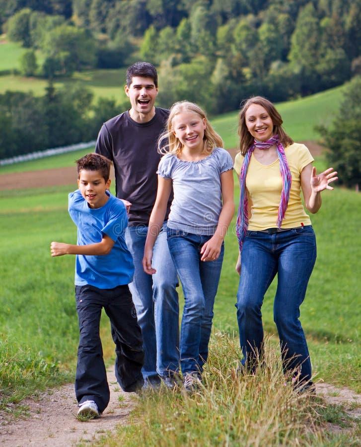 Family-fun 23. Cute family having fun in a meadow stock image