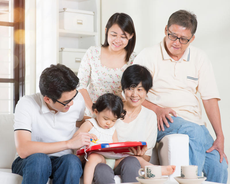 Family fun. Asian multi generations lifestyle at home. Happy family portrait stock images