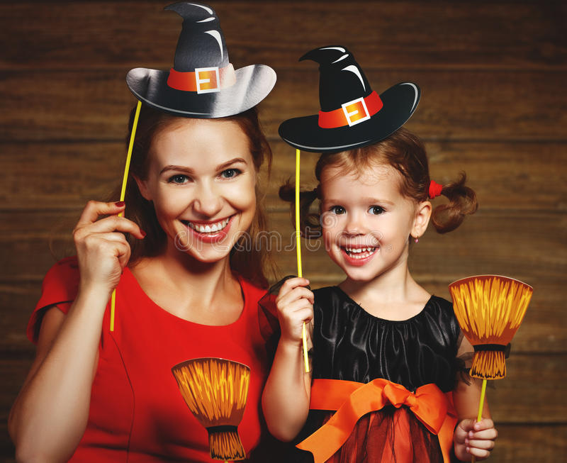 Family fun mother and child daughter celebrate Halloween in witc royalty free stock photography