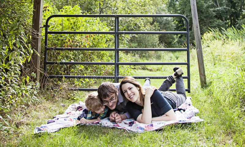Family fun picnic. Happy family playing on a blanket outside stock photos