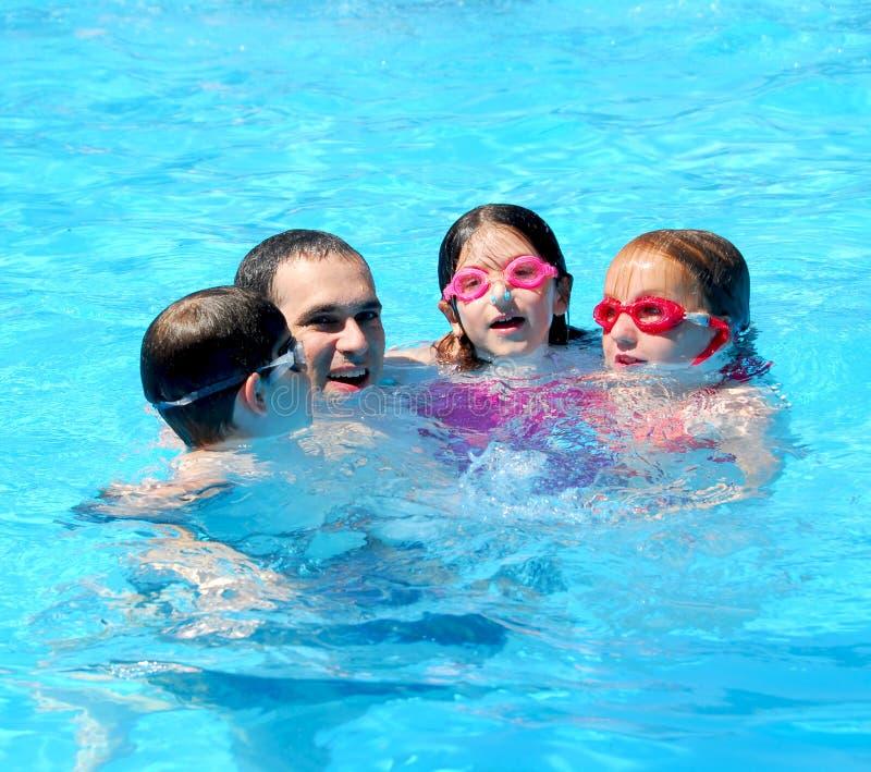 Family fun pool stock photo