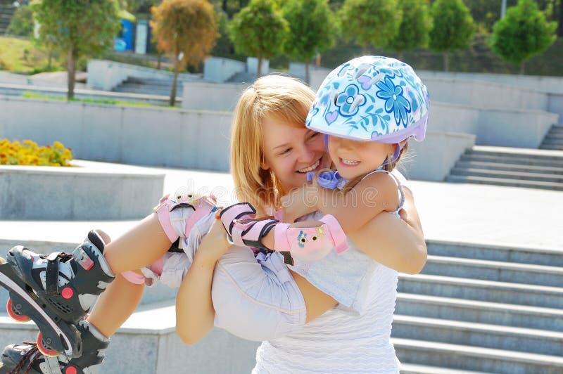 Family fun rollerblading royalty free stock image