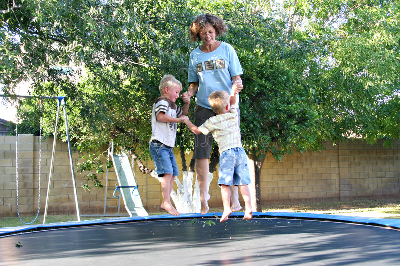 Download Family Fun On The Trampoline Stock Photo - Image of childhood, grandchild: 6441228
