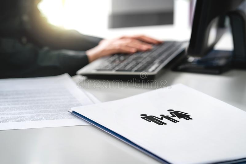 Family future, health care or finance planning concept. Woman writing insurance or mortgage application with computer. royalty free stock photo