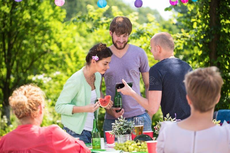 Family on a garden party stock photos