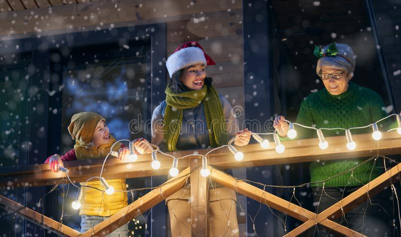 Family with garlands outside stock photo